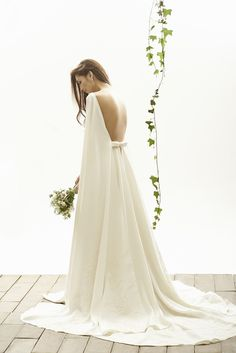 Camilla wedding dress from Vania Romoff Bridal wedding dresses 2015 - Unique wedding dress with cape detail and open back with gorgeous feminine bow - see the rest of the collection on www.onefabday.com