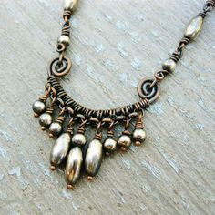 Antiqued Copper and Silver Dangles wire wrapped necklace.