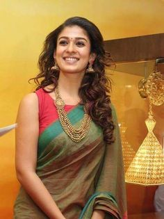 Nayanthara at a GRT Jewellers event in Dubai wearing a Green handloom cotton saree paired with red sleeveless boat neck blouse. Indian Dresses, Indian Outfits, Simple Sarees, Elegant Saree, Elegant Dresses, Saree Look, Actrices Hollywood, Handloom Saree, Kurti