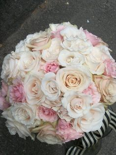 All Rose Bridal Bouquet - If you want tradition, this all-rose bouquet is perfect for the occasion.  A mix of over 20 beautiful  roses, garden roses and spray roses.  Also available in Ivory , lavender, yellow, red or hot pink.  Finished with your choice of double-faced satin ribbon or burlap and lace and pearl or crystal pins.