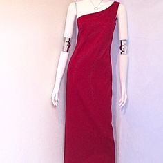 "My Michelle Off the Shoulder Formal Dress My Michelle Off the Shoulder Red Formal Dress. Size 5/6. Red Jewel Detailing in front of dress. 100% Polyester, Hand Wash Cold. Made in the USA. Measurements: Armpit to Armpit 15"", Waist 14.5"", Length 55"". My Michelle Dresses"