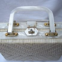 """Mod! Vintage WHITE Wicker Straw Rattan Basketweave Summer Box handbag White Pearlized Lucite Handles; light blue cotton lining DESIGNER: Handmade for Crown Colony; made in Hong Kong Marked SIZE: 5 1/2"""" x 9 1/2""""  Material: Rattan, Straw, Lucite Condition: Great Vintage Condition  Additional ... Crown Colony, White Wicker, Vintage Handbags, Indie Brands, Basket Weaving, Rattan, Hong Kong, Light Blue, Box"""