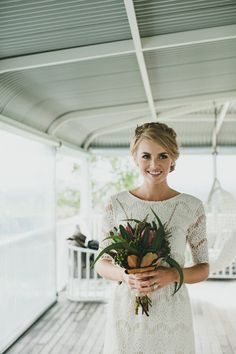 ivory lace bridesmaid gown, photo by Shane Shepherd http://ruffledblog.com/byron-bay-farm-wedding #bridesmaids #lacedress