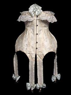 Corset, jacquard silk, metal stiffeners,elastic suspenders, silk ribbons, circa 1900.