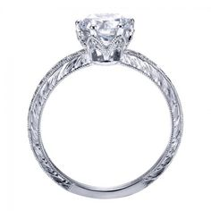 I love the vintage inspired engraving on this engagement ring! So pretty!