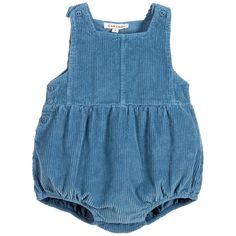 Blue dungaree shortie byCaramel Baby & Child, made in soft cotton corduroy, with buttons on the shoulders and side to fasten. The leg cuffs are elasticated and there are poppers between the legs for easy nappy changes. Suitable for both boys and girls.
