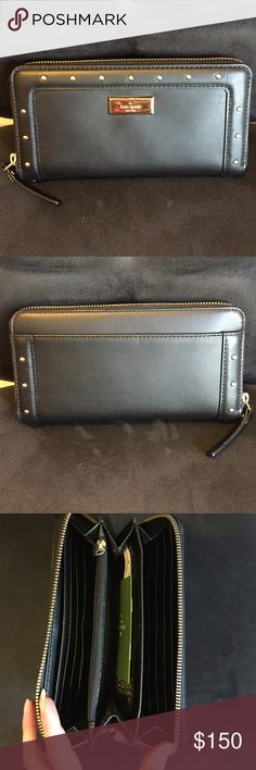 NWOT Kate Spade Wallet New! Never used! Can't find the tag so I can't supply that with the purchase. Black with 14 karat gold plated hardware. Zip around continental wallet. kate spade Bags Wallets