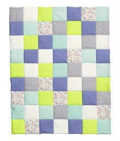 Check this out! BABY EXCLUSIVE. Padded, quilted blanket in woven cotton fabric with various printed patterns and colors at front for a patchwork quilt effect. Solid color at back. Polyester padding. Size 27 1/2 x 35 1/2 in. - Visit hm.com to see more.