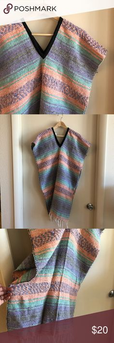 Hand Woven Mexican Blanket Molina Poncho OS Awesome vintage Mexican blanket poncho in pastel colors. One size fits all - perfect for camping, summer evening concerts in the park, or to keep in the car as a just-in-case layer! It can double as a picnic blanket as well. Good used condition with typical pilling. Machine washable! Snap this up before I keep it. Photos are unedited and represent colors well. Purple, coral/peach are dominant colors.   50% acrylic  40% polyester  20% cotton…