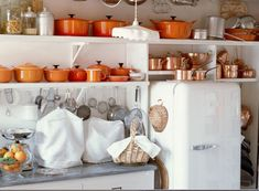 neutral kitchen with pops of color. would love to recreate with a variety of blue le crueset.
