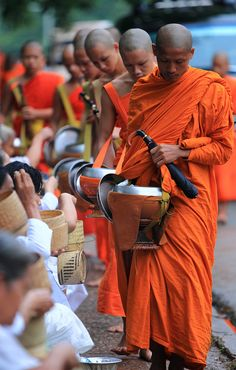 Tak bat, an important living tradition in Luang Prabang, Laos. Please respect the morning alms giving ceremony.