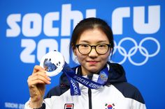 Silver medalist Suk Hee Shim of South Korea celebrates during the medal ceremony for the Short Track Speed Skating Womenfs 1500m (c) Getty Images