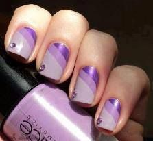 Three shades of purple with a purple crystal accent stone - tipped at an angle, free hand nail art, scotch tape or nail tape technique