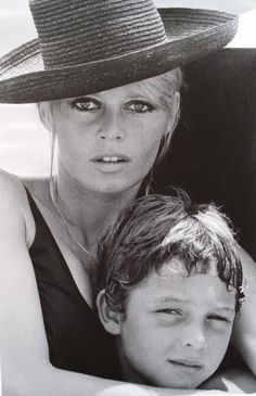 1969 or 1970 - Brigitte Bardot sailing with her son, Nicolas-Jacques Charrier. shes in a black bathing suit and stylish black hat