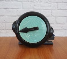1950's Shawnee Pottery Sundial Casserole Dish // Black and Turquoise MidCentury Art Deco Design // Retro Kitchenware by FireflyVintageHome on Etsy