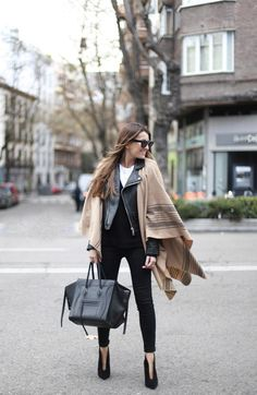 Throw a cape over your leather jacket for a modern spin on this edgy staple   How to Wear a Poncho Like a Street-Style Star   StyleCaster