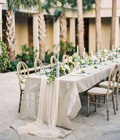 chiffon table runners with greenery runner and candlesticks
