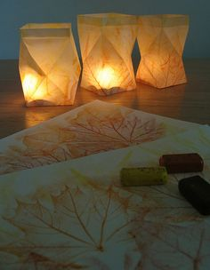 Paper Lanterns.  Folding instructions here:  http://bobbinsandbrambles.blogspot.com/2010/11/lantern-tutorial.html