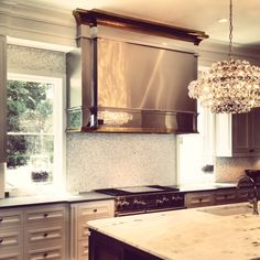 Handcrafted Custom Mirror Finished Stainless Steel Vent Hood with Mirror Finished Brass Trim #luxurykitchen #interiorkitchendesign #kitchenrenovation #KitchenMirror #stainlesssteelhood #venthoodenvy #beachsheetmetal