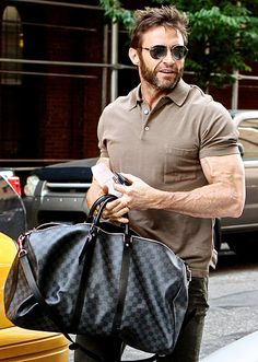 Hugh Jackman showed off his buff, veiny arms hailing a cab in NYC May 28.