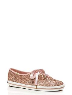 I love the idea of slipping into these glittery ked sneakers by Kate Spade for walking around the mountains for photos or for dancing