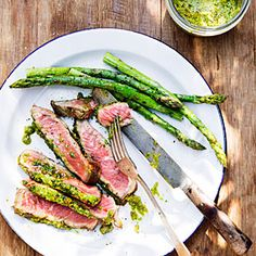 Flavorful and generously marbled, rib-eye makes a restaurant-worthy splurge whether at home or out camping, particularly when topped with a distinctively flavored butter. The amount of pistachio butter is generous; if you like, turn the asparagus in some of it right after the spears come off the grill and top the steaks with the rest.