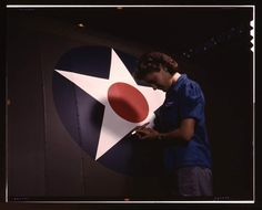 """A candid view of one of the women workers touching up the U. Army Air Forces insignia on the side of the fuselage of a """"Vengeance"""" dive bomber manufactured at Vultee's Nashville division, Tennessee (LOC) by The Library of Congress, Feb. Rare Pictures, Colorful Pictures, Ww2 Women, Military Women, Shorpy Historical Photos, Photo Restoration, Rosie The Riveter, Nose Art, Working Woman"""