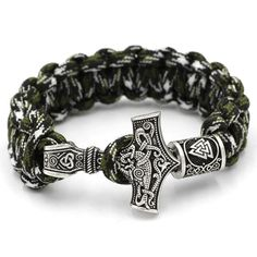 Strength GivingParacord Bracelet with a Mjolnir (Thor's Hammer)Clasp Gain Strength, Power and protection wearing this Paracord Bracelet with a legendary Norse Mjolnir Clasp. The Mjolnir is the Norse God Thor's Hammer. Each bracelet comes with a rune amulet charm which slides on one end of the paracord bracelet.If