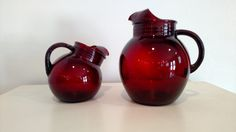 No chips or cracks. Very cute set! The slanted one stands about 6-1/4 tall The large pitcher stands about 9 tall and approximately 7-1/2 wide with the handle.