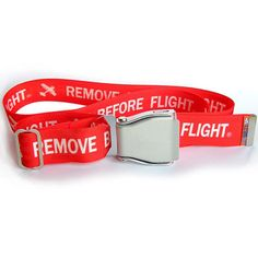 """The Remove Before Flight SkyBelt is a fully adjustable belt with an authentic commercial airline buckle.  The belt features the phrase """"Remove Before Flight"""" in white on a red belt.  This 1.5"""" wide belt fits through most standard belt loops and is interchangeable with other belt colors.  The SkyBelt is made in the USA and adjusts up to 32"""" for a small/medium belt and up to 42"""" for a medium/large belt."""