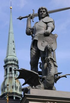 Statue of a warrior slaying a dragon in Riga, Latvia