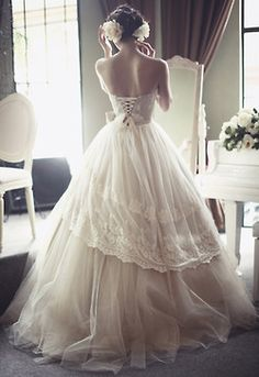 wedding dress lace. I'm ok with a corset back as long as its just the top and stops at my waist