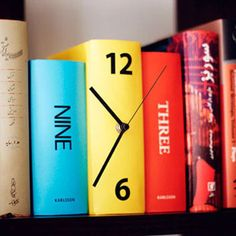 Book Clock! $30 on Amazon, but I wonder if I could make this with a craft store clock kit, paint books solid colors, add clock hands, connect books, add vinyl sticker numbers?