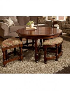 Round Coffee Table With Nesting Stools Is Very Practical For Small Living Rooms