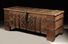 An early-16th century, Westphalian, iron-banded, oak chest or 'stollentruhe'