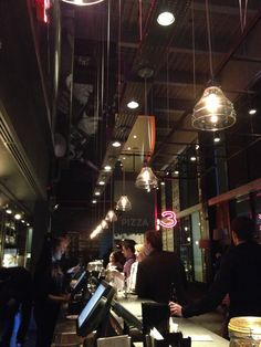 The American-style interior typically New York Lighting and Bar Design create a rustic but eclectic experience for customers.