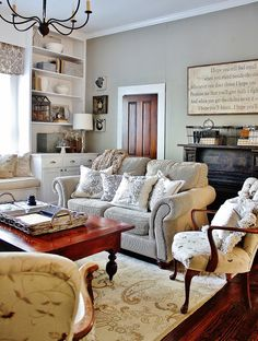 Simple, white, off white, & gray/blue tones are dominate colors. Then normal wood tones in furniture, in limited amounts on the deep wood color floor. Wonder what the TV area looks like.