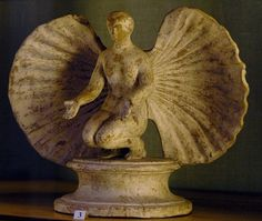 Aphrodite (Venus) in a shell, Hellenistic statuette (terracotta), 3rd-2nd century AD, (The Hermitage, St Petersburg).
