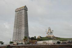 "Murudeshwar, Karnataka  Murudeshwara is a town in the Bhatkal Taluk of Uttara Kannada district in the state of Karnataka, India. ""Murudeshwara"" is another name of the Hindu god Shiva. Famous for the world's tallest Shiva statue, this beach town lies on the coast of the Arabian Sea and is also famous for the Murudeshwara Temple."