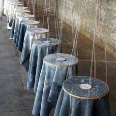 Caroline Bartlett, hanging embroidery hoops with work in it! brilliant! The art of display!