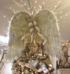 BREATHTAKING! i had angel wings on our tree the past Christmas,,,,