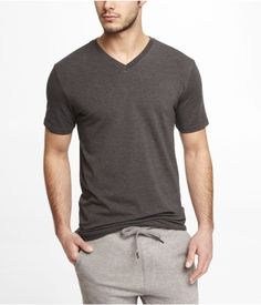 TALL STRETCH COTTON V-NECK TEE | Express This shirt has black and white brothers that make great undershirts, but I always love grey for wearing by itself. This shirt would be just fine for running a couple errands on the weekend, a jog, or doing laundry.