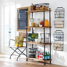 cute little kitchen storage area. Love the French shopkeeper's shelves.