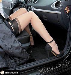 Black top nude stockings with black velvet heels by a woman in her car. www.misslegs.fr