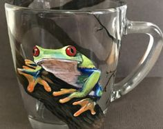 Tree Frog Coffee Tea Mug Hand Painted Glass Rainforest Art Jungle Colorful Animal Kitchen Cafe Collectible Science Woodsy Rustic Nature Red Decorated Wine Glasses, Painted Wine Glasses, Painted Rocks, Hand Painted, Red Eyed Tree Frog, Glass Votive Candle Holders, Gifts For An Artist, Colorful Animals, Realistic Paintings