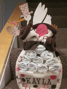 Cute baby shower gift. Diapers and a personalized huggies wipe container.