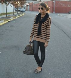 Replace the leather pants with black jeggings or dark wash skinny jeans. I like this sweater too