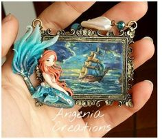 Today's bit of story was created by Angenia (also known as Tonia Angenia Lupo) of Italy. While the mermaid turned out lovely, we're really focusing on the painting. It's a masterful rendition of a Thomas Kinkade piece in polymer clay! She did a fabulous job at applying polymer in a painterly fashion. Come see more of her work and our Inspirational Challenge at The Polymer Arts magazine blog, http://www.thepolymerarts.com/blog/11872