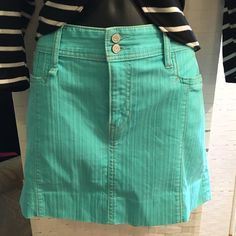 Gap Aqua Denim mini skirt NWOT never worn sz 12 Gap mini skirt zip and 2 button fly closure,  front pockets smooth back. Beautiful Aqua color great for spring and summer! GAP Skirts Mini