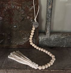 This wood bead garland is so lovely and has a loop to hang it anywhere